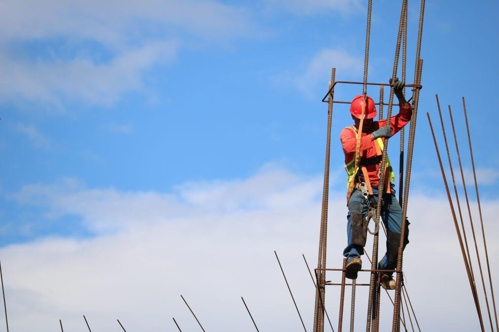 Constuction worker adjusting rebar